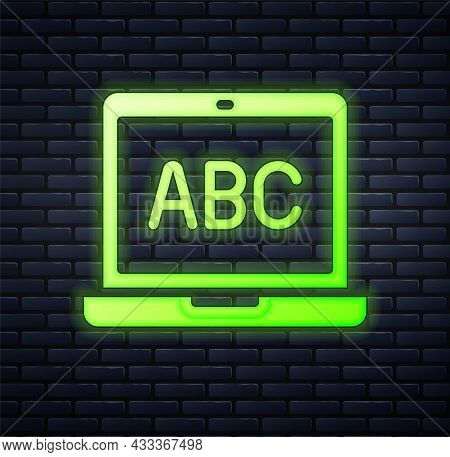 Glowing Neon Laptop Icon Isolated On Brick Wall Background. Computer Notebook With Empty Screen Sign