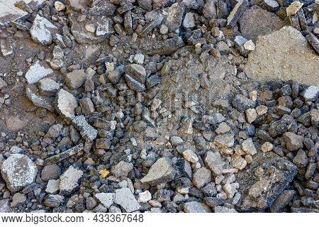 Destroyed Asphalt. Broken Road Surface. Fragments Of Asphalt Pavement.