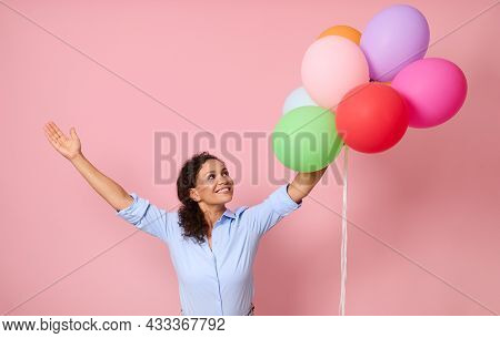 Waist Length Portrait Of Cheerful, Happy Smiling With Toothy Smile Of Beautiful Curly Haired Woman R