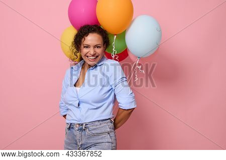 Charming Joyful African Woman In Blue Shirt Laughing And Smiling With Toothy Smile Looking At The Ca