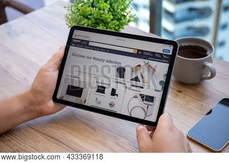 Alanya, Turkey - July 7, 2021: Man Holding Apple Ipad Air Space Gray With Online Shopping Service Am