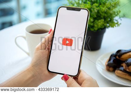Alanya, Turkey - August 3, 2021: Woman Hand Holding Apple Iphone 12 Pro Max Gold With App Youtube Pr