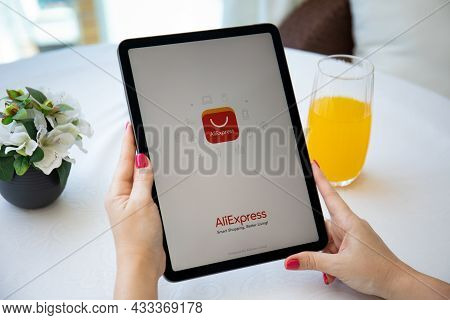 Alanya, Turkey - August 3, 2021: Woman Hand Holding Ipad Air Space Gray With Internet Shopping Servi