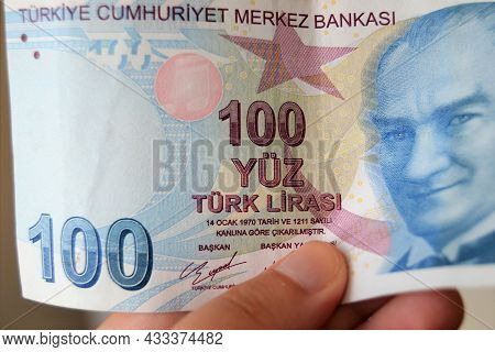 Hand Holding 100 Turkish Lira Bill,note In Close Up.currency Of Turkey.