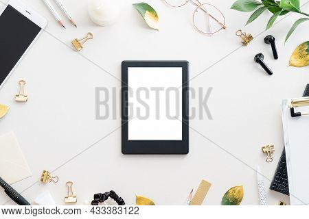 E-book Reader, E-reader Mockup On White Table With Office Stationery Top View. Flat Lay.