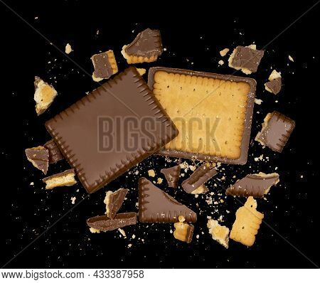 Butter Biscuit Cakes With Chocolate And Lots Of Broken Pieces Around In Black Back