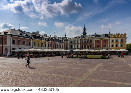 The Great Market Square In Old Town Zamosc With Colorful Buildings And Restaurants