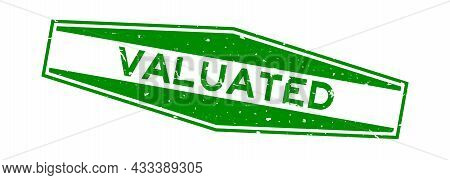 Grunge Green Valuated Word Hexagon Rubber Seal Stamp On White Background