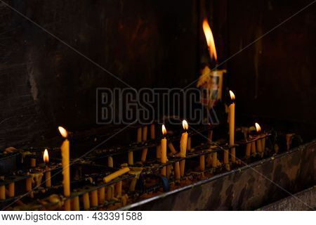 Candles And Fire Placed On Candlestick To Worship The Buddha In The Temple.