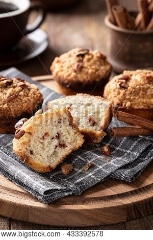 Cinnamon Streusel Nut Muffins On A Wooden Platter With Coffee And Cinnamon Sticks In Backgound