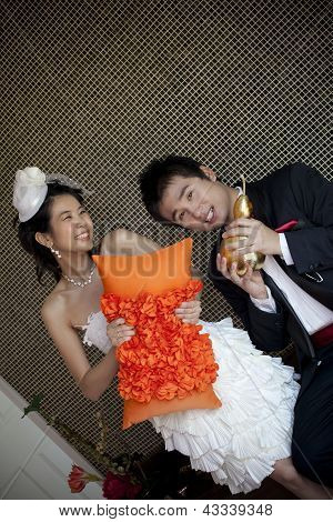 Happy Face Of Groom And Bride In Wedding Suit At Home