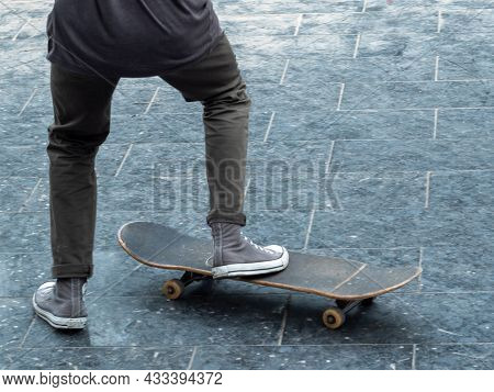 Leisure Activity. Sportive Lifestyle. Young Skateboarder In The Public Park. Youth Leisure Concept.