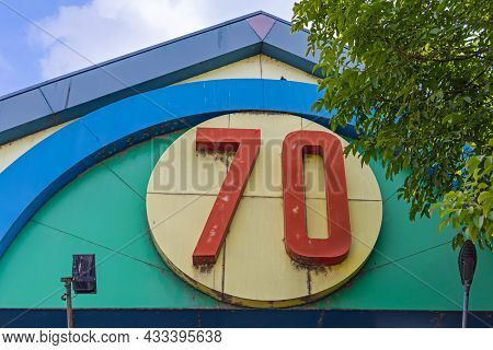 Big 3d Number Seventy At Colourful Building Exterior
