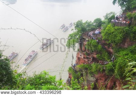 June 24, 2018.  Leshan, China. Looking Down At The Tourist Boats And Tourist Walking Down The Steps