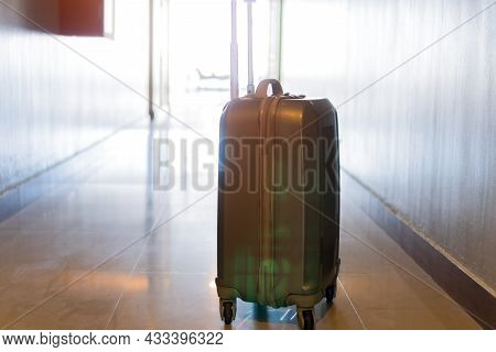 Traveler Suitcase In Walkway In Hotel For Enjoyable Trip Ready Travel. Preparation In Baggage Journe