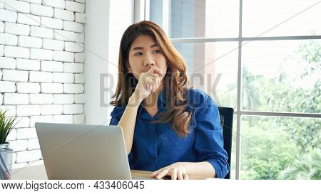 Woman Streching Arm Raised Sitting Incorrect Position Home Office Desk. Back Side Of Young Asian Wom