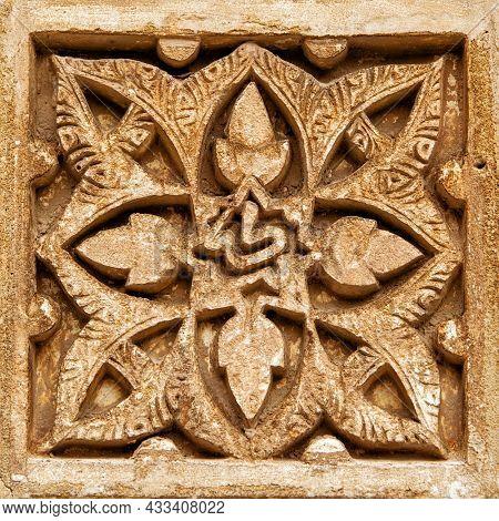 Flower - Ancient moorish stone carving, Spain