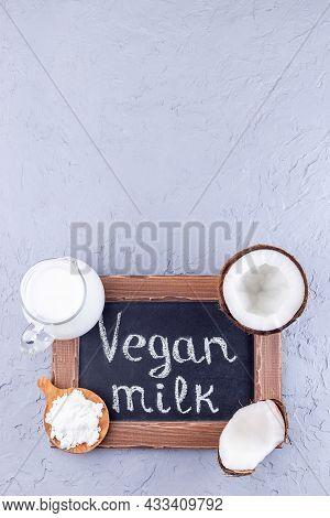 Chalk Board And Vegan Powdered Coconut Milk, Lactose Free Milk In Glass Jar, Vertical, Top View, Cop
