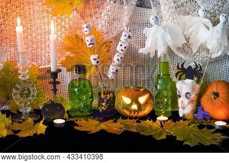 Buffet Table With Sweets And Drinks, Cooked And Decorated In Honor Of Halloween. Various Desserts An