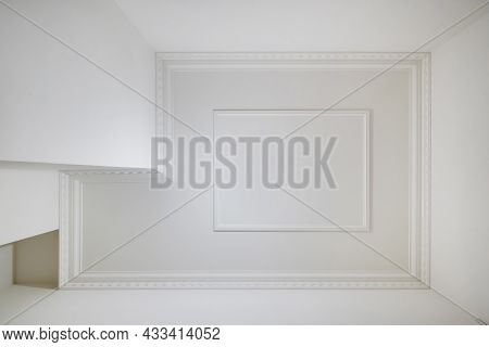 Corner Of Ceiling And Walls With Intricate Crown Moulding. Interior Construction And Renovation Conc