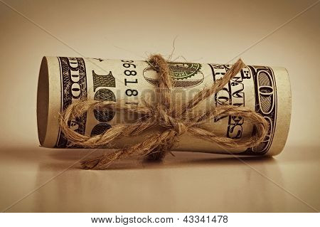Rolled-up Hundred Dollar Banknote