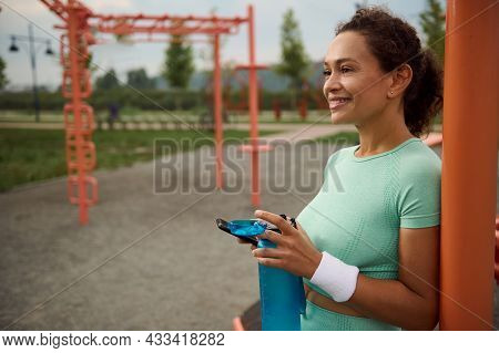 Happy Gorgeous Wellbeing Mixed Race African American Middle Aged Woman Drinking Water After Outdoor