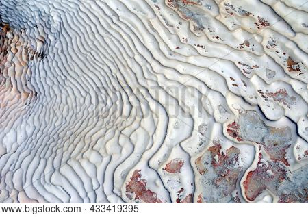 Pamukkale travertine texture. Wavy limestone textured deposits on terraces of carbonate minerals in Pamukkale, Turkey.