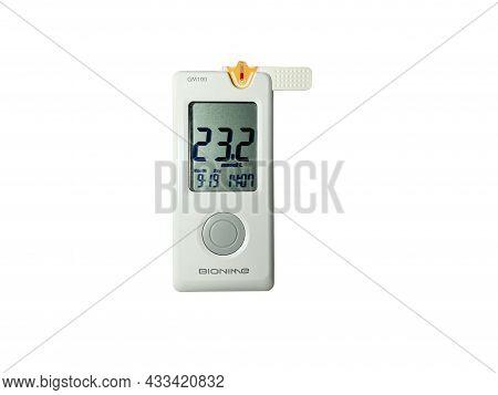 Grodno, Belarus - 09.19.2021: Measurement Of Blood Sugar Using A Bionime Glucose Meter. Dangerously