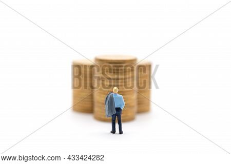 Business, Money Investment And Planning Concept. Businessman Miniature Figure People Figure With Jac