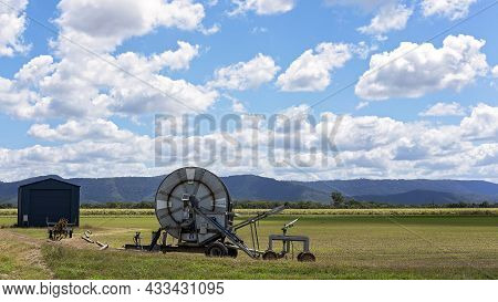 Koumala, Via Mackay, Queensland, Australia - September 2021: An Irrigation Hose On A Reel Standing I