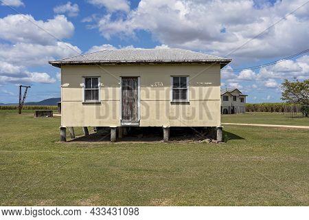 Koumala, Via Mackay, Queensland, Australia - September 2021: A Small Timber Workers Cottage On A Cou
