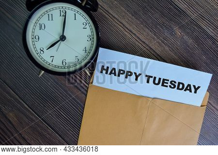 Happy Tuesday Text On Document Above Brown Envelope.