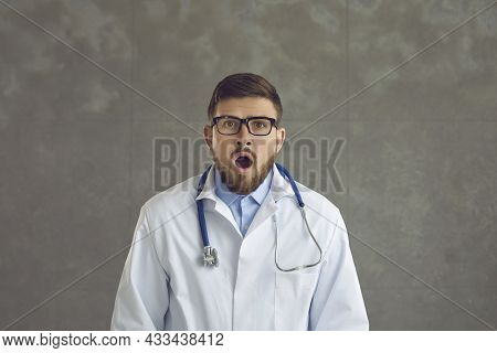 Portrait Of A Shocked Doctor Looking At Camera Astonished By Something Outstanding