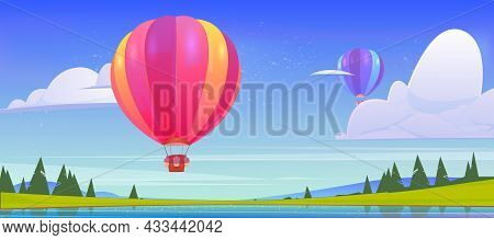 Hot Air Balloons Flying Above Pond, Green Field And Mountain Peaks In Blue Sky. Scenery Nature Summe