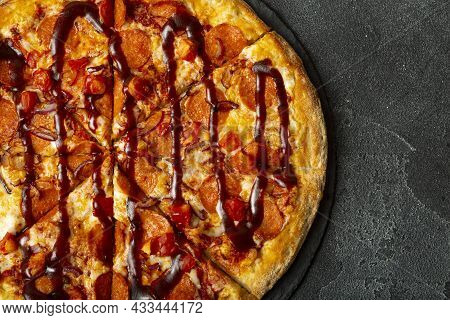 Delicious Fresh Pepperoni Pizza On A Stone Background. Top View Of Pepperoni Pizza. Flat Lay. With C