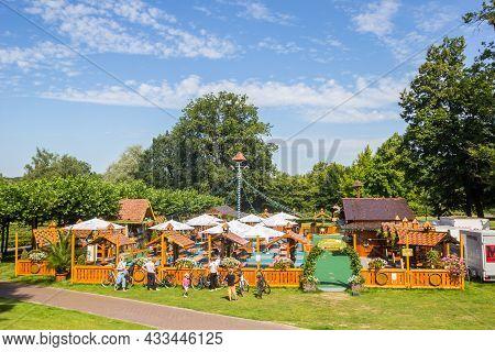 Bad Bentheim, Germany - August 15, 2021: People In Front Of The Beer Garden In The Park In Bad Benth