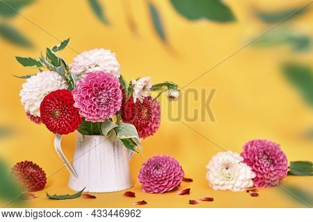 Autumn Dahlias Flowers Bouquet On Yellow Table. Wall Table Background, Copy Space