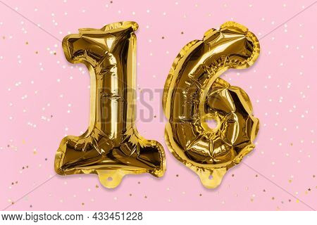 The Number Of The Balloon Made Of Golden Foil, The Number Sixteen On A Pink Background With Sequins.