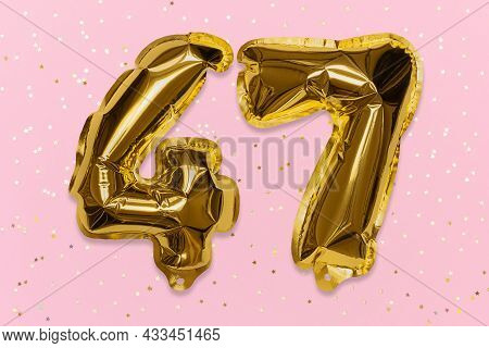 The Number Of The Balloon Made Of Golden Foil, The Number Forty-seven On A Pink Background With Sequ