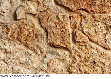 Pattern Masonry Wall Texture Closeup. Old Stone Building Facade As Background For Banner And Design