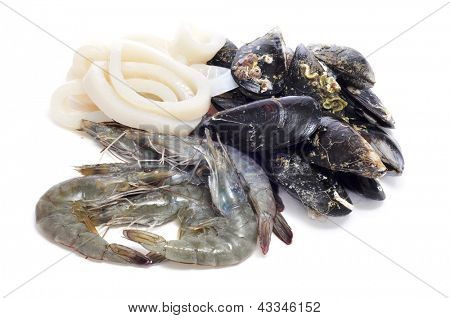 a pile of different raw seafood, such as shrimps, mussels and squid rings