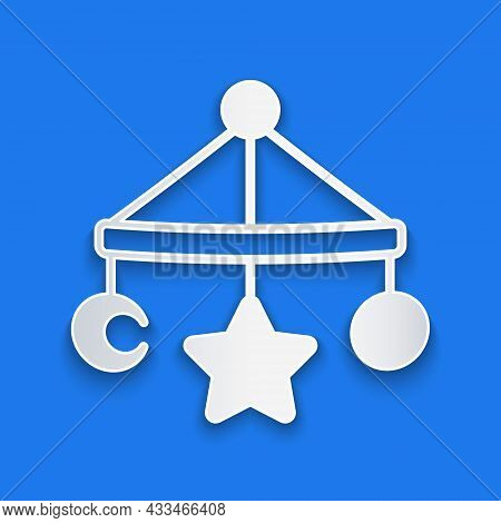 Paper Cut Baby Crib Hanging Toys Icon Isolated On Blue Background. Baby Bed Carousel. Paper Art Styl