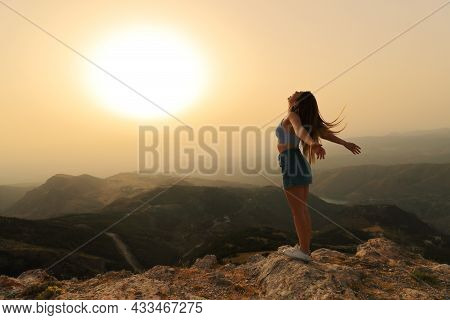 Happy Woman Celebrating Success Breathing And Screaming Stretching Arms At Sunset