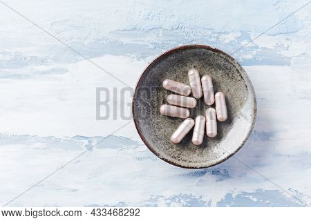 Carnitine Capsules. Concept For A Healthy Dietary Supplementation. Bright Wooden Background. Soft Fo