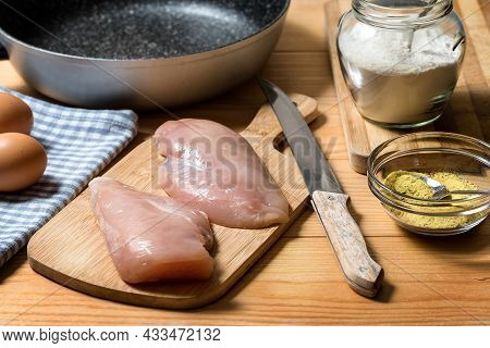 Chicken Fillet On A Cutting Board Ready For Grilling. Raw Chicken Breast With Grill Pan, Flour And S