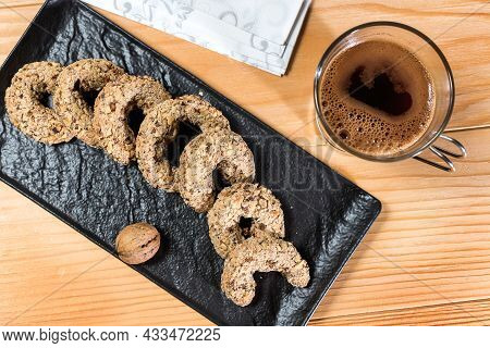 Traditional Walnut Horseshoe Cookies - Orasnice On A Serving Plate With Coffee. Top View