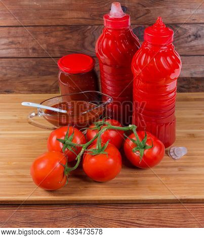 Different Tomato Sauces And Ketchups In Different Containers And Gravy Boat, Fresh Ripe Red Tomatoes