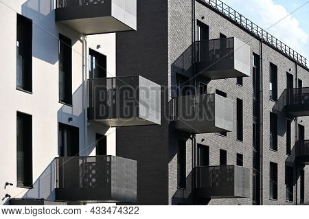 Modern Residential Apartment And Flat Building Exterior. New Luxury House And Home Complex