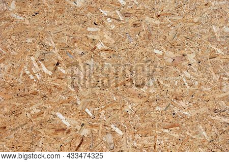 Osb (oriented Strand Board), Rough Surface Of Chipboard Recycled Wood Made By Compressing Tiny Piece