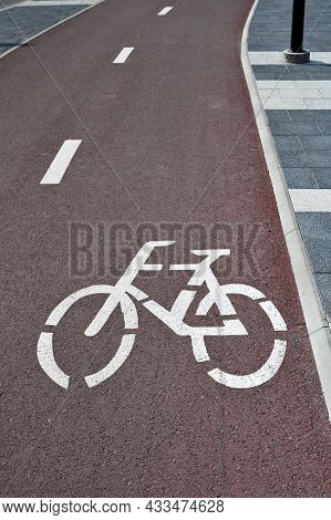 Separate Bicycle Lane For Riding Bicycles. A White Bicycle Symbol On The Road